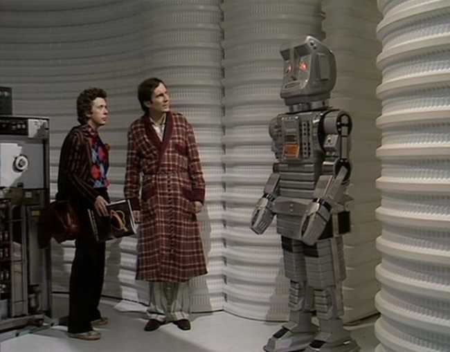 Marvin the Paranoid Android with Arthur and Ford from the older BBC series.